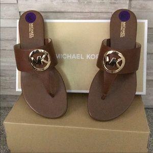 New with box Michael Kors tan, gold logo sandals